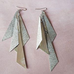 Gold glittering dangled earrings